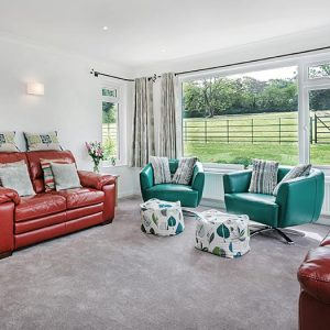 Sofa and chairs in a large living area in a Devon holiday cottage in mid Devon.