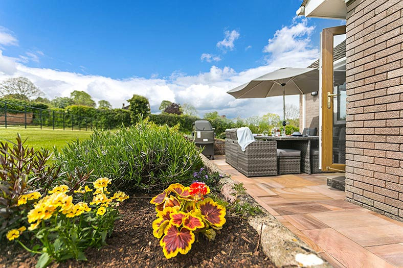 The patio and barbecue at Cloveshayes holiday cottage in Devon is perfect for relaxing