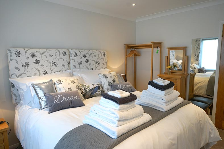 A super king bedroom at Clovehayes, luxury holiday cottage in central Devon.